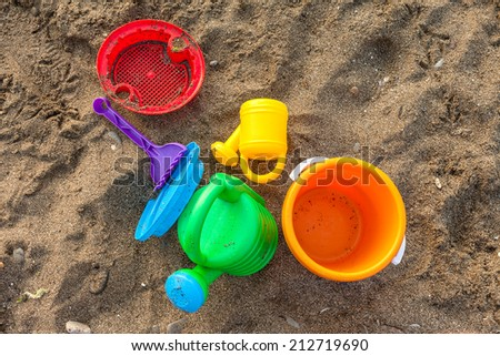 Plastic children toys on the sand beach - stock photo