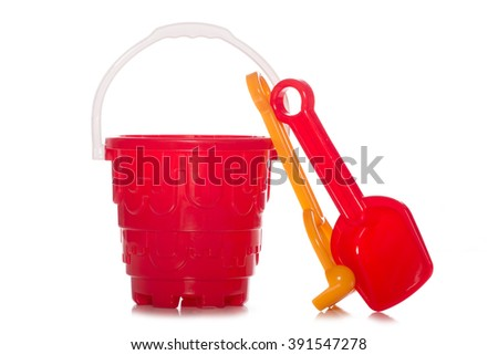 plastic childrens bucket and spade studio cutout - stock photo