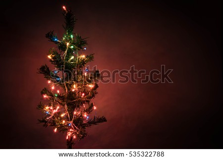 Plastic Christmas Tree Decorated with colored lights