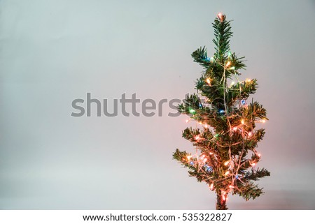 plastic christmas tree decorated with colored lights - Plastic Christmas Tree
