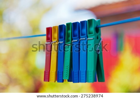 Plastic clothespin hanging on rope, depth of field