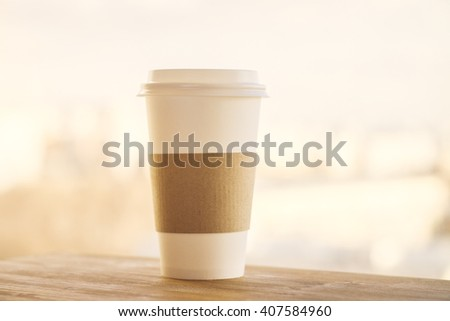 Plastic coffee cup on wooden desktop and yellow background. Mock up - stock photo