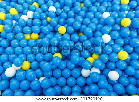 plastic colorful blue bouncy ball in close up background