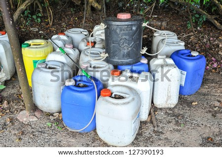 plastic container of insecticide for farmer