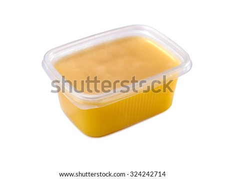 plastic container with ghee butter isolated on white background  - stock photo