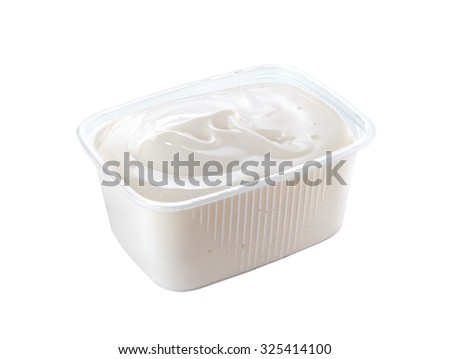 plastic container with sour cream isolated on white background  - stock photo