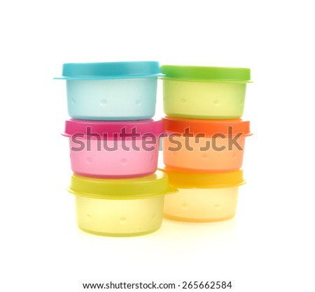 Plastic containers for food with lid ajar isolated on white colorful - stock photo