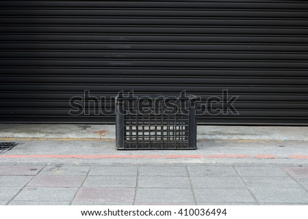plastic crate for transport and city trash cans - stock photo