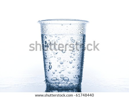 Plastic cup with water on wet surface. Duotone image.