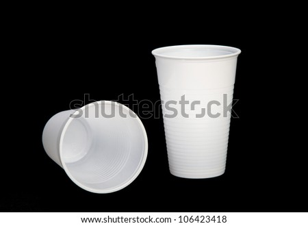 plastic cups of coffee on black background - stock photo