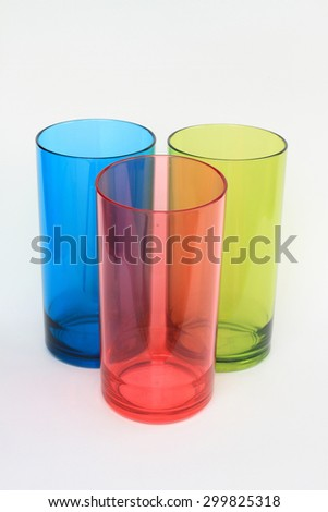 Plastic cups of various color isolated on white background