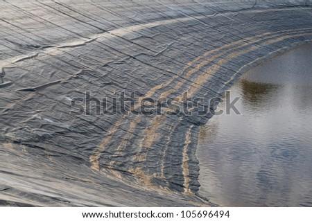 Plastic dam liner to stop water leakage - stock photo