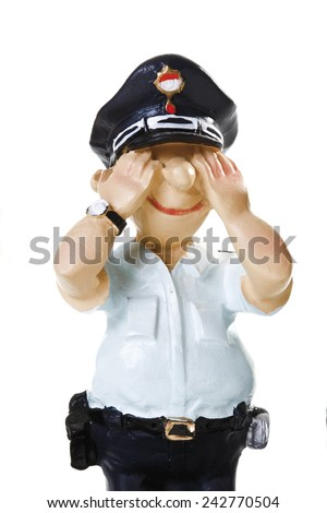 Plastic Figurine of a Policeman, See no evil, close-up - stock photo