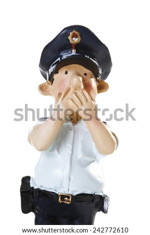 Plastic Figurine of a Policeman, Speak no evil, close-up - stock photo