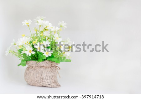 Plastic Floral Bouquet of Flowers on isolated background - stock photo