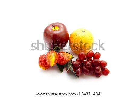 Plastic Fruits on white background