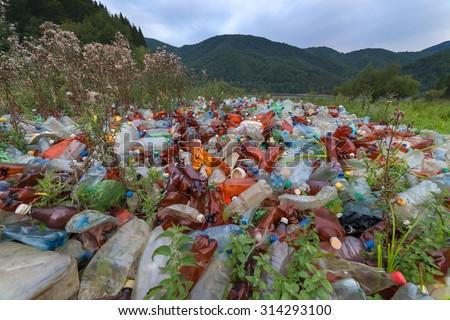 plastic garbage on mountains closeup - stock photo