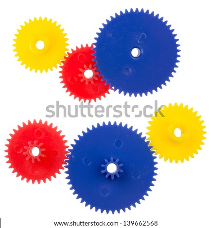 Plastic gearing wheels, isolated against background - stock photo