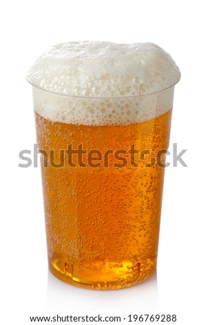 Plastic glass of beer isolated on white background - stock photo