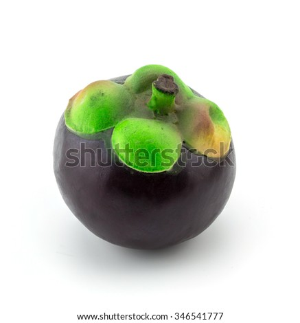 Plastic grape fruit, decorated with artificial  accessory, on white background, clipping path