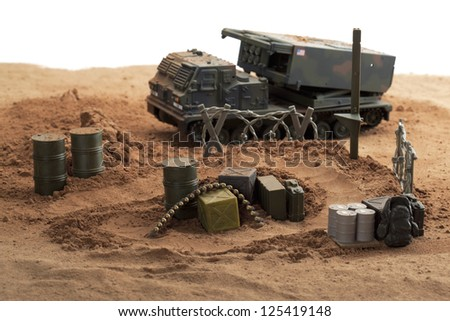 Plastic Green Tracked Army Vehicle on a battlefield - stock photo