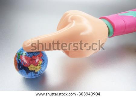 Plastic Hand and Globe - stock photo