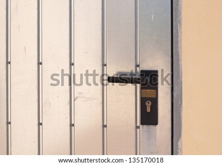 plastic handle of a metal door