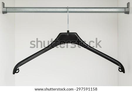 Plastic hanger in the closet - stock photo