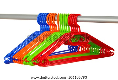 plastic hangers in row  isolated on white
