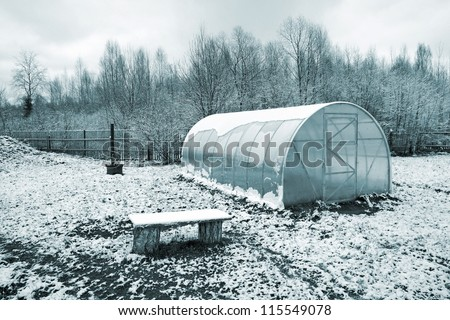 plastic hothouse in winter garden - stock photo