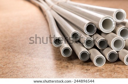 Plastic industrial tubes - stock photo