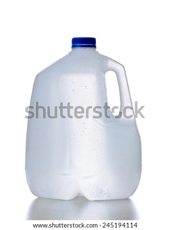 Plastic jug, recyclable and reusable bottle jug container for water, milk and other liquids with no tag and drops on the surface, isolated on white background with reflection - stock photo
