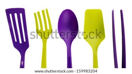 Plastic kitchen utensils isolated on white - stock photo