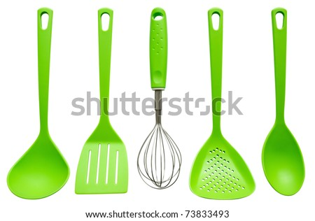 Plastic kitchen utensils isolated on white. Clipping path included. - stock photo