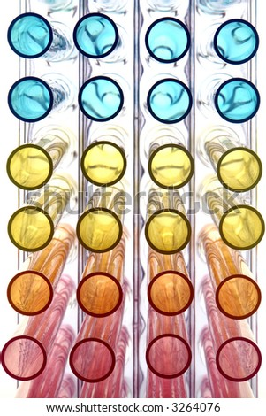 Plastic laboratory test tubes in rainbow colors on a rack in a science research lab  - stock photo