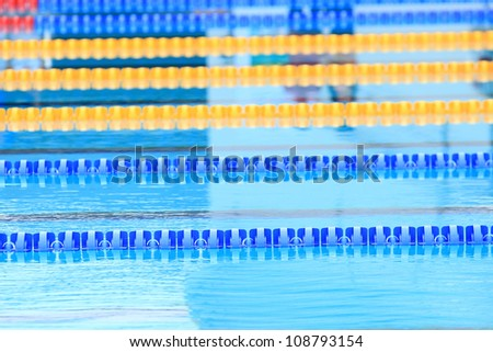 plastic lanes in swimming pool. - stock photo