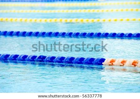 plastic lanes in swimming pool. - stock photo