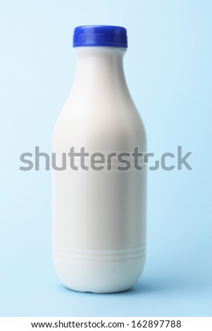 Plastic Milk Bottle On Blue Background - stock photo