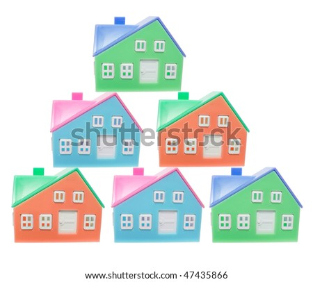 Plastic Miniature Houses on White Background