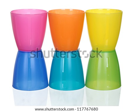 plastic multi-colored glasses isolated on a white background. Plastic glass of various color isolated on white background - stock photo