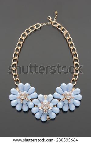 plastic necklace. three blue flower - stock photo