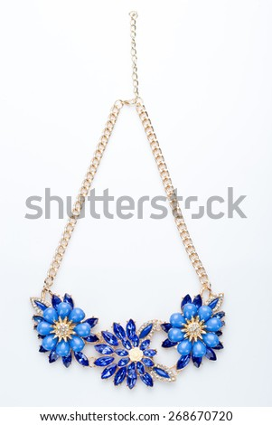 plastic necklace. three blue flower - stock photo