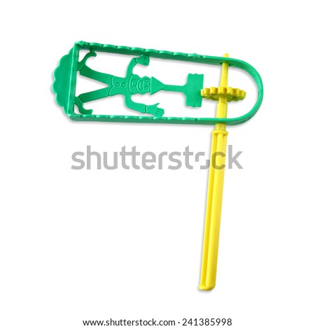 plastic noisemaker or gragger for purim celebration (jewish holiday) - stock photo