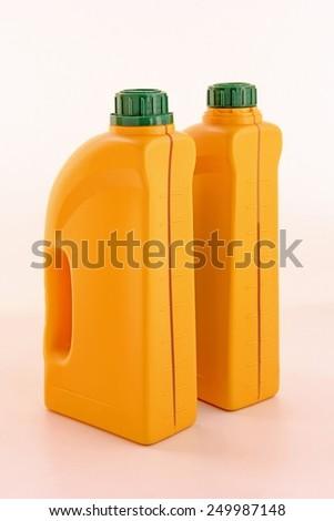 Plastic orange detergent bottles. - stock photo