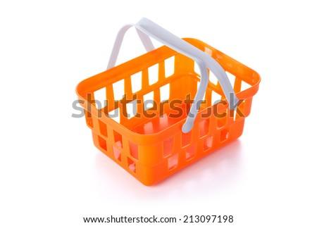 Plastic orange shopping basket on white background. - stock photo