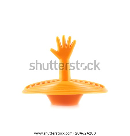 Plastic orange sink plug shaped as a sinking hand isolated over the white background - stock photo