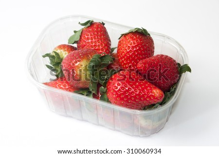 Plastic package of strawberries on the white background.