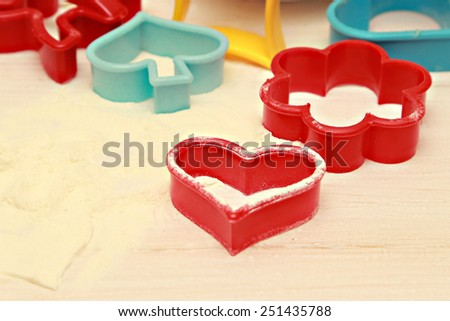 Plastic pastry cutters, Colorful plastic pastry cutters on white table  - stock photo