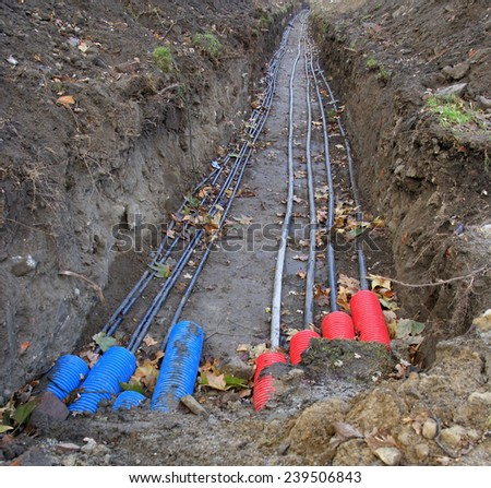 Plastic pipes containing electric cables/wires in the ground
