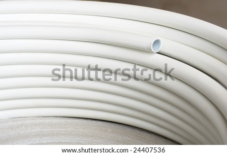Plastic pipes in roll - stock photo
